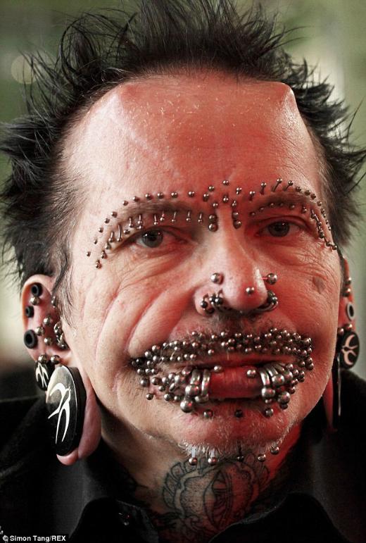 man-wih-453-piercings